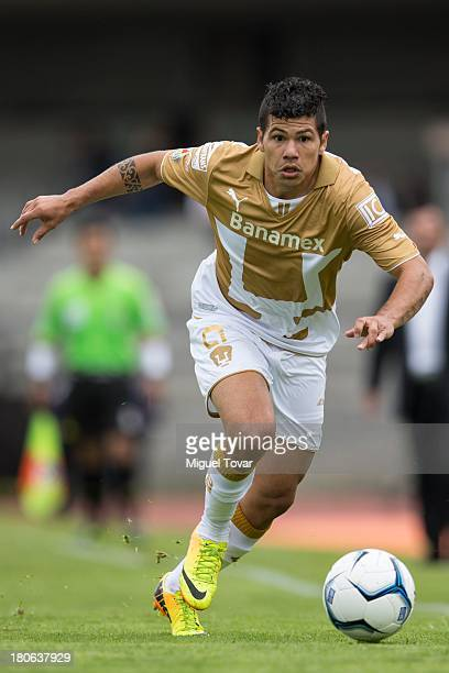 Robin Ramirez of Pumas drives the ball during a match between Pumas and Morelia as part of the Apertura 2013 Liga MX at Olympic stadium on September...