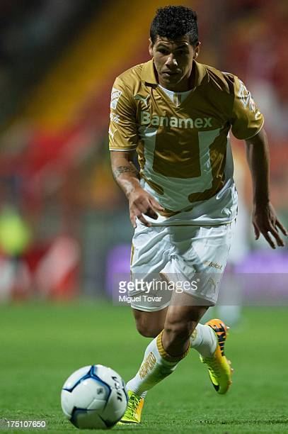 Robin Ramirez of Pumas drives the ball during a match between Toluca and Pumas as part of the Torneo Apertura 2013 Liga MX at Nemesio Siez stadium on...