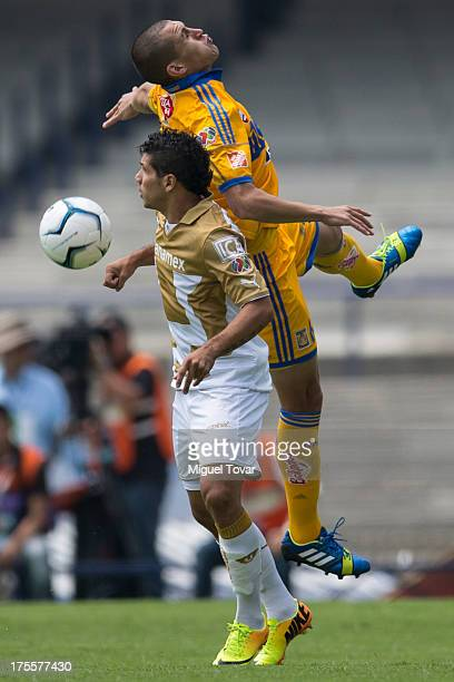 Robin Ramirez of Pumas fights for the ball with Jorge Torres Nilo during a match between Pumas and Tigres as part of the league MX at Olympic stadium...