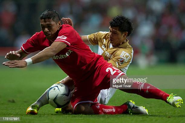 Robin Ramirez of Pumas fights for the ball with Richard Ortiz of Toluca during a match between Toluca and Pumas as part of the Torneo Apertura 2013...