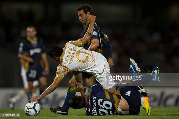 Robin Ramirez of Pumas struggles for the ball with Alfonso Rippa of Atletico San Luis during a match between Pumas and Atletico San Luis as part of...
