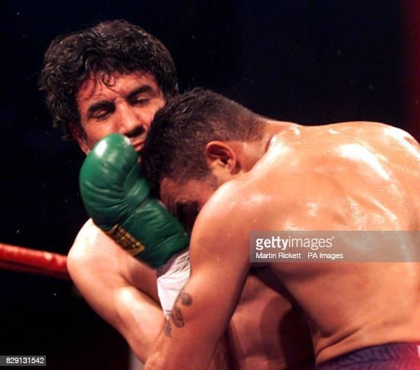 Robin Reid battles with Argentina's Jorge Sclarandi during the WBF SuperMiddleweight bout at Kelvin Hall Glasgow Scotland Reid defeated Sclarandi in...