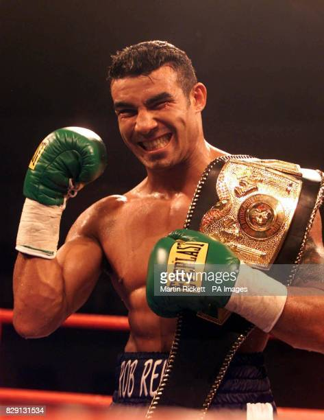 Robin Reid celebrates with the WBF SuperMiddleweight belt after defeating Argentina's Jorge Sclarandi in the third round at Kelvin Hall Glasgow...