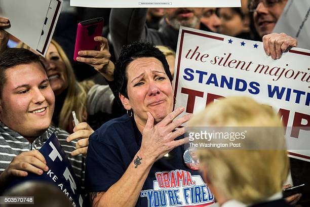 Robin Roy reacts to Republican candidate for President Donald Trump meeting spectators after a rally in Lowell Massachusetts on Monday evening...