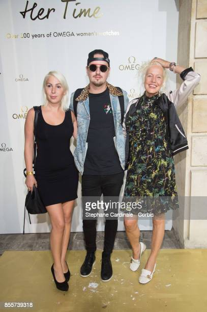 Robin Schulz and Ellen Von Unwerth attend the 'Her Time' Omega Photocall as part of the Paris Fashion Week Womenswear Spring/Summer 2018 at on...