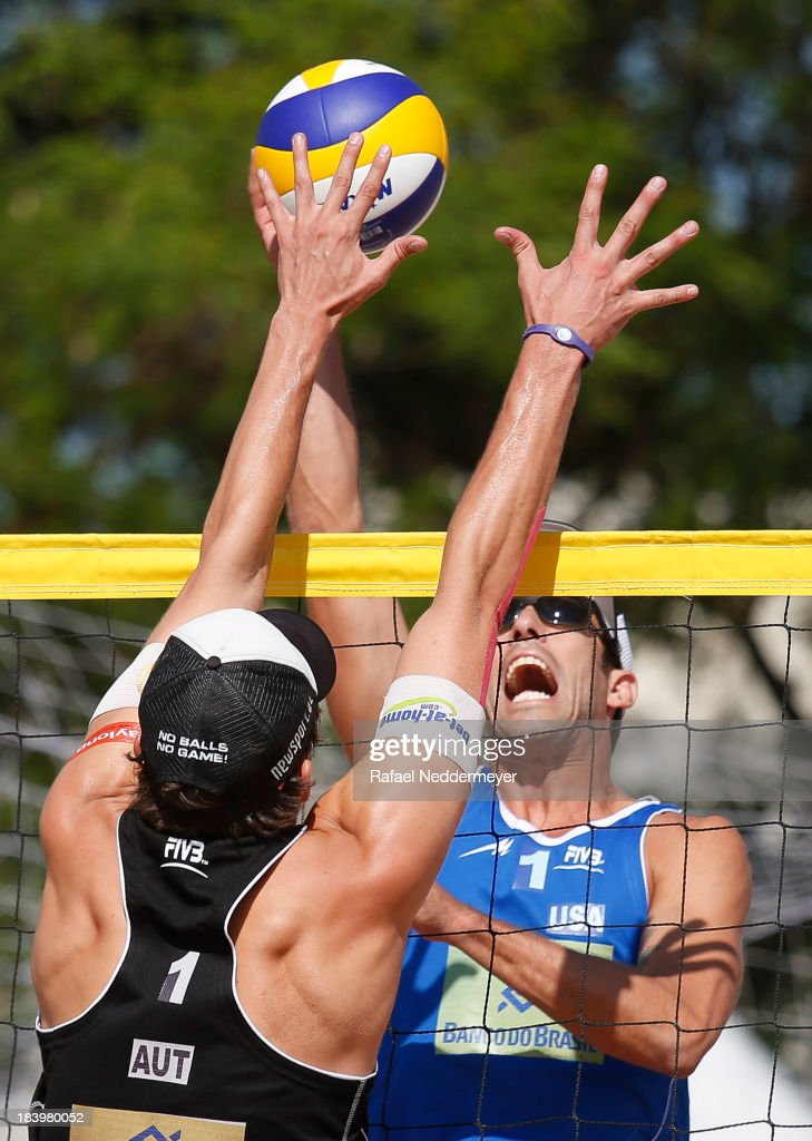 Robin Seidl of Austria (L) and Nick Lucena of United States in action during day third of the FIVB Beach Volleyball Sao Paulo Grand Slam 2013 at Parque Villa Lobos on October 10, 2013 in Sao Paulo, Brazil.