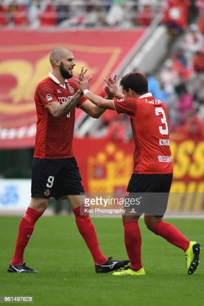 Robin Simovic and Kazuki Kushibiki of Nagoya Grampus celebrate their 32 victory in the JLeague J2 match between Nagoya Grampus and Shonan Bellmare at...