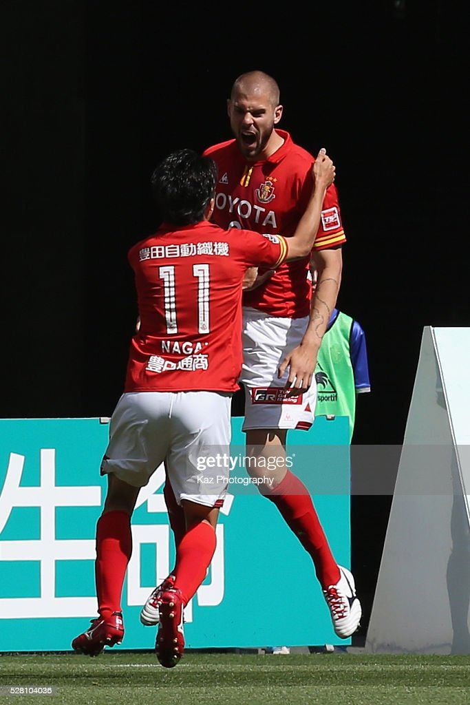 Robin Simovic (R) of Nagoya Grampus celebrates scoring his team's first goal with his team mate <a gi-track='captionPersonalityLinkClicked' href=/galleries/search?phrase=Kensuke+Nagai&family=editorial&specificpeople=6548859 ng-click='$event.stopPropagation()'>Kensuke Nagai</a> (L) during the J.League match between Nagoya Grampus and Yokohama F.Marinos at the Toyota Stadium on May 4, 2016 in Toyota, Aichi, Japan.
