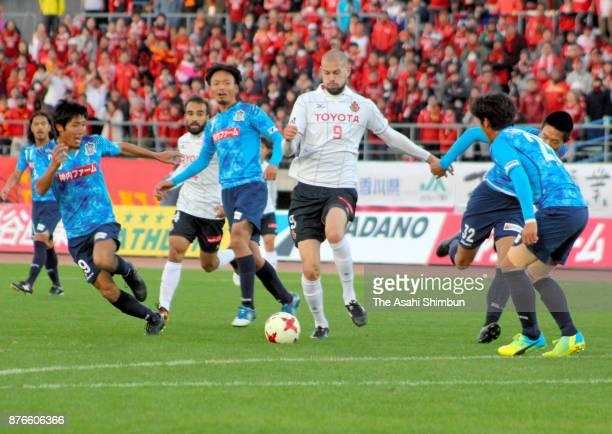 Robin Simovic of Nagoya Grampus controls the ball under pressure of Kamatamare Sanuki defense during the JLeague J2 match between Kamatamare Sanuki...