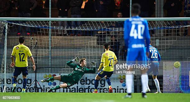 Robin Soder of Esbjerg fB scores the 10 goal against Goalkeeper Frederik Ronnow of Brondby IF during the Danish Alka Superliga match between Esbjerg...