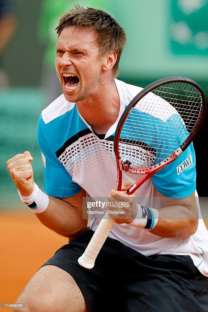 Robin Soderling of Sweden celebrates matchpoint during the men's singles round four match between Gilles Simon of France and Robin Soderling of Sweden on day nine of the French Open at Roland Garros on May 30, 2011 in Paris, France.