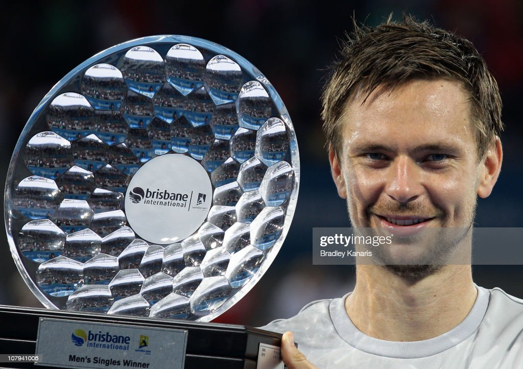 Robin Soderling of Sweden holds the winners trophy as he celebrates victory after his finals match against Andy Roddick of the USA during day eight of the Brisbane International at the Queensland Tennis Centre on January 9, 2011 in Brisbane, Australia.