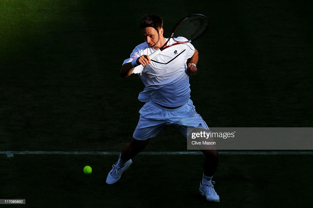 Robin Soderling of Sweden returns a shot during his first round match against Philipp Petzschner of Germany on Day Two of the Wimbledon Lawn Tennis Championships at the All England Lawn Tennis and Croquet Club on June 21, 2011 in London, England.
