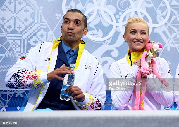 Robin Szolkowy and Aliona Savchenko of Germany wait for their score during the Figure Skating Pairs Short Program on day four of the Sochi 2014...