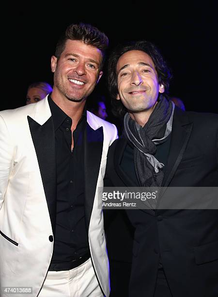 Robin Thicke and Adrien Brody attend the De Grisogono party during the 68th annual Cannes Film Festival on May 19 2015 in Cap d'Antibes France