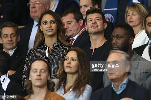Robin Thicke and April Love Geary attend the French Ligue 1 match between Paris SaintGermain and Stade de Reims at Parc des Princes stadium on May 23...