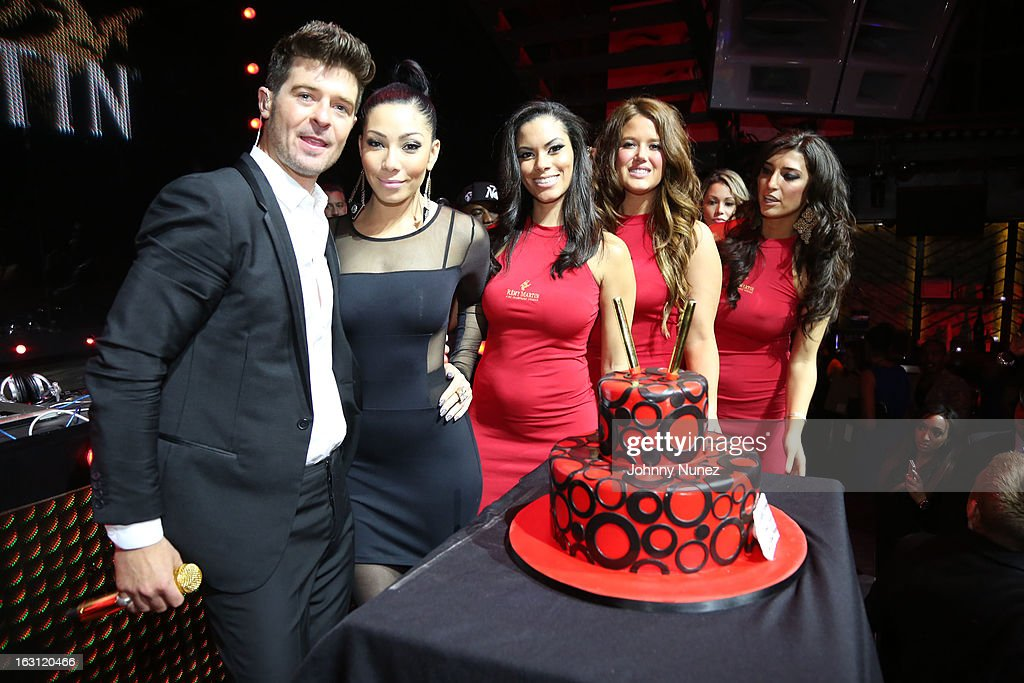 Robin Thicke (L) and Bridget Kelly (second from left) attend the Remy Martin V.S.O.P Ringleader Culmination Event with Robin Thicke at Marquee on March 4, 2013 in New York City.