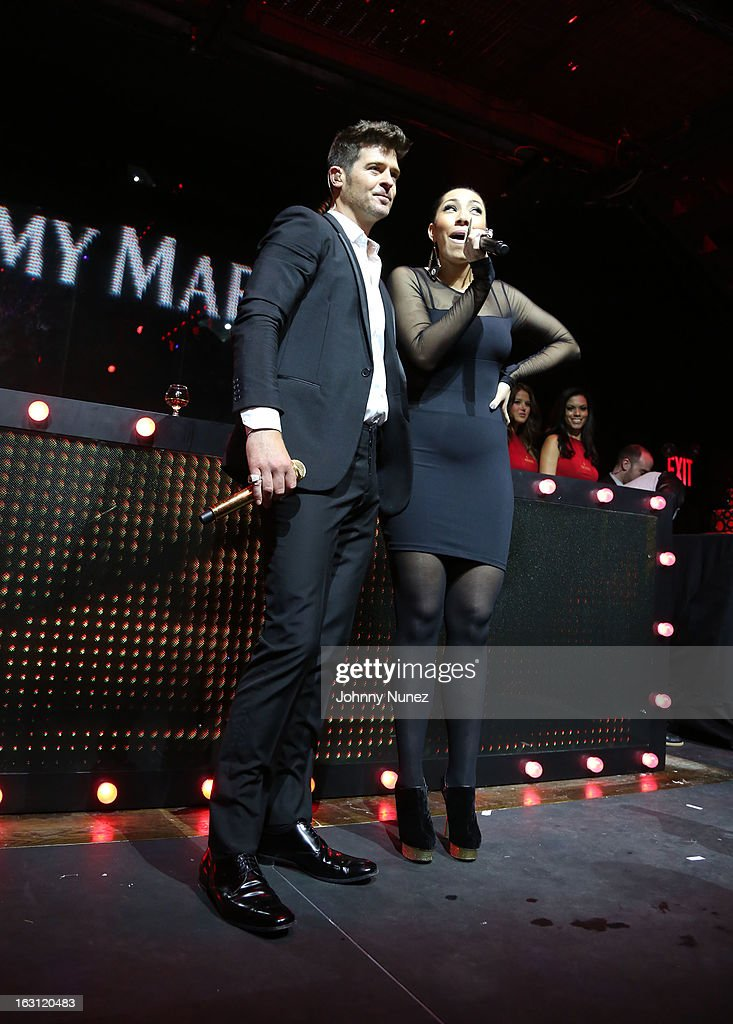 <a gi-track='captionPersonalityLinkClicked' href=/galleries/search?phrase=Robin+Thicke&family=editorial&specificpeople=724390 ng-click='$event.stopPropagation()'>Robin Thicke</a> and Bridget Kelly perform at the Remy Martin V.S.O.P Ringleader Culmination Event with <a gi-track='captionPersonalityLinkClicked' href=/galleries/search?phrase=Robin+Thicke&family=editorial&specificpeople=724390 ng-click='$event.stopPropagation()'>Robin Thicke</a> at Marquee on March 4, 2013 in New York City.