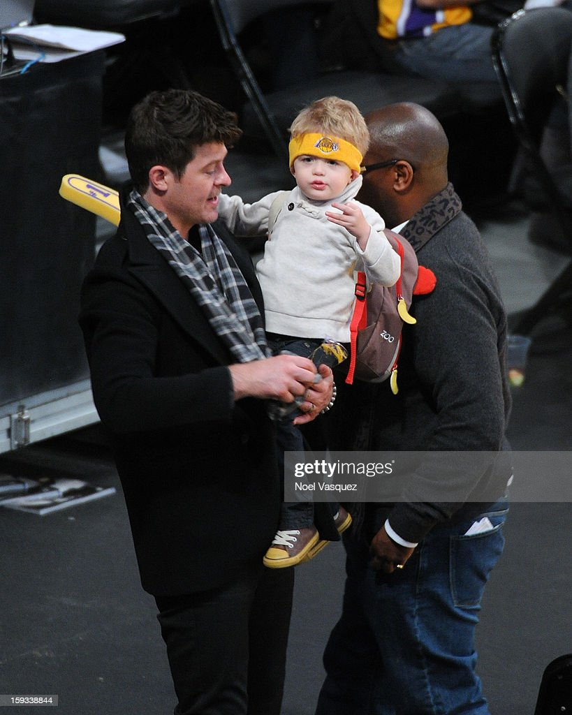 <a gi-track='captionPersonalityLinkClicked' href=/galleries/search?phrase=Robin+Thicke&family=editorial&specificpeople=724390 ng-click='$event.stopPropagation()'>Robin Thicke</a> (L) and his son Julian Fuego Thicke attend a basketball game between the Oklahoma City Thunder and the Los Angeles Lakers at Staples Center on January 11, 2013 in Los Angeles, California.