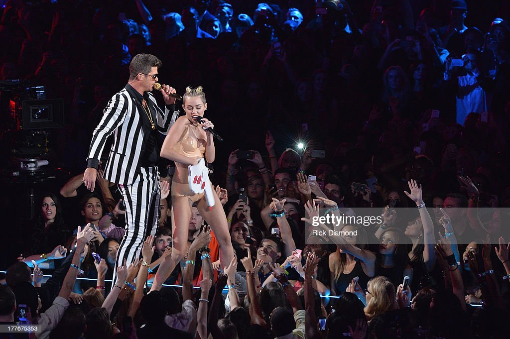 Robin Thicke and Miley Cyrus perform onstage during the 2013 MTV Video Music Awards at the Barclays Center on August 25 2013 in the Brooklyn borough...