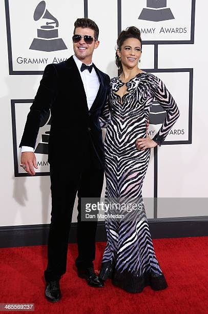 Robin Thicke and Paula Patton arrive at the 56th Annual GRAMMY Awards at Staples Center on January 26 2014 in Los Angeles California
