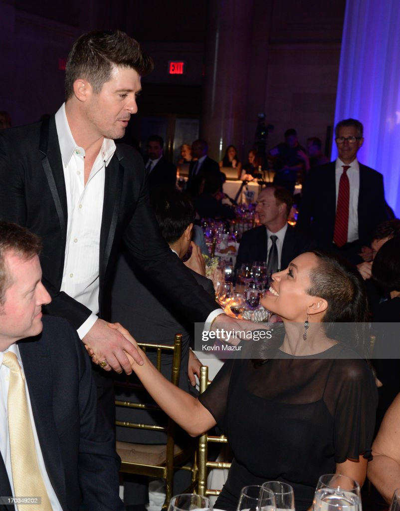 Robin Thicke and Rosario Dawson attend the Samsung's Annual Hope for Children Gala at CiprianiÕs in Wall Street on June 11, 2013 in New York City.