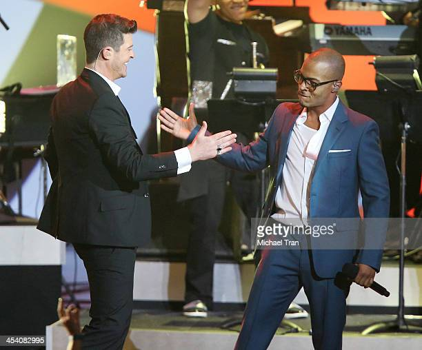 Robin Thicke and TI perform at the GRAMMY Nominations Concert Live held at Nokia Theatre LA Live on December 6 2013 in Los Angeles California