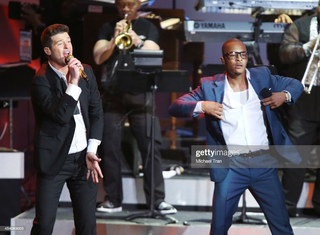 <a gi-track='captionPersonalityLinkClicked' href=/galleries/search?phrase=Robin+Thicke&family=editorial&specificpeople=724390 ng-click='$event.stopPropagation()'>Robin Thicke</a> (L) and <a gi-track='captionPersonalityLinkClicked' href=/galleries/search?phrase=T.I.&family=editorial&specificpeople=221599 ng-click='$event.stopPropagation()'>T.I.</a> perform at the GRAMMY Nominations Concert Live! held at Nokia Theatre L.A. Live on December 6, 2013 in Los Angeles, California.