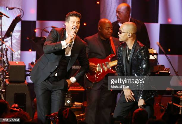 Robin Thicke and TI perform onstage during the Clive Davis and The Recording Academy present The Annual PreGRAMMY Gala held at The Beverly Hilton...