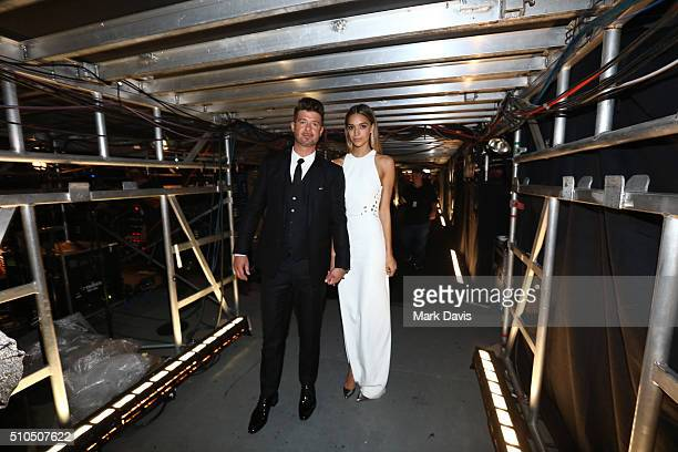 Robin Thicke April Love Geary attend The 58th GRAMMY Awards at Staples Center on February 15 2016 in Los Angeles California