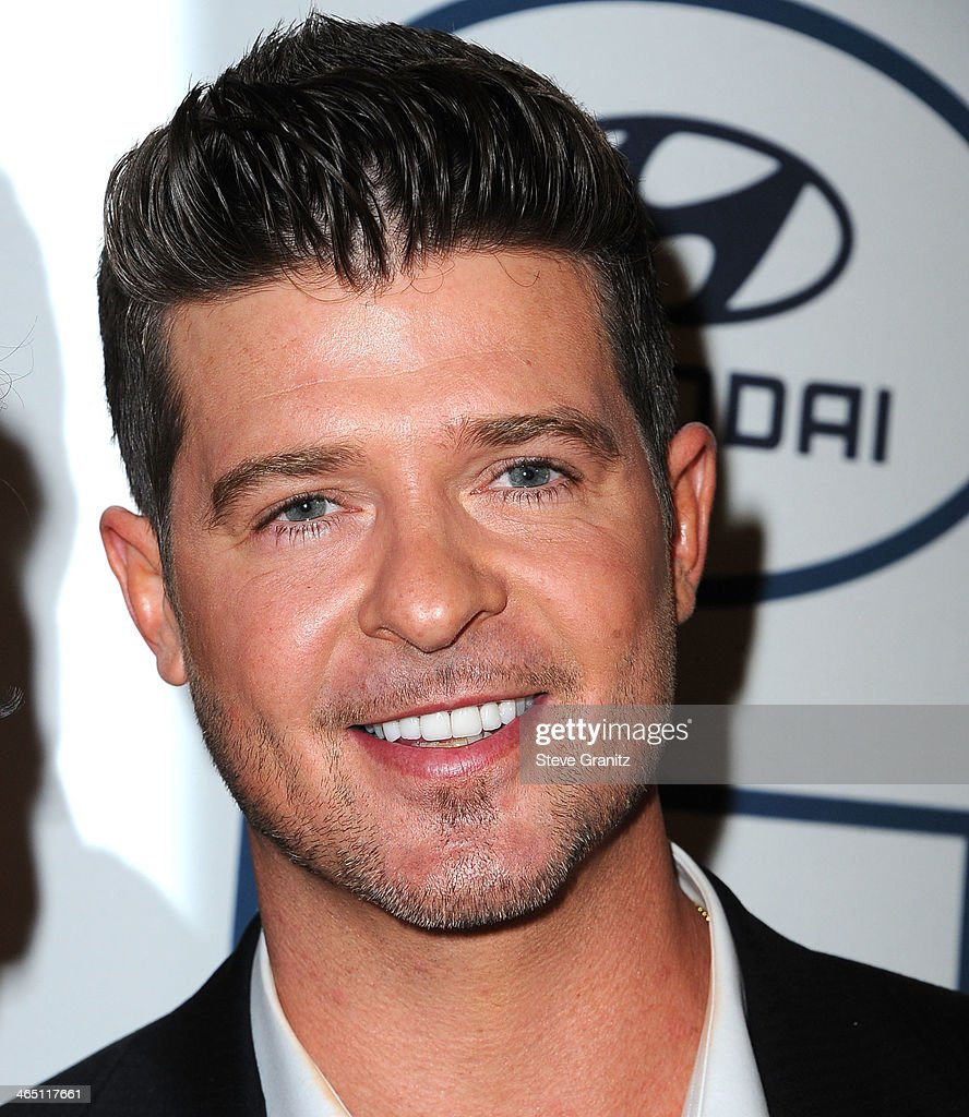 <a gi-track='captionPersonalityLinkClicked' href=/galleries/search?phrase=Robin+Thicke&family=editorial&specificpeople=724390 ng-click='$event.stopPropagation()'>Robin Thicke</a> arrives at the Clive Davis And The Recording Academy Annual Pre-GRAMMY Gala at The Beverly Hilton Hotel on January 25, 2014 in Beverly Hills, California.