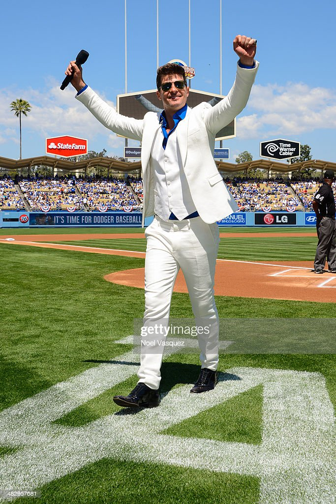 <a gi-track='captionPersonalityLinkClicked' href=/galleries/search?phrase=Robin+Thicke&family=editorial&specificpeople=724390 ng-click='$event.stopPropagation()'>Robin Thicke</a> attends a baseball game between the San Francisco Giants and the Los Angeles Dodgers at Dodger Stadium on April 5, 2014 in Los Angeles, California.