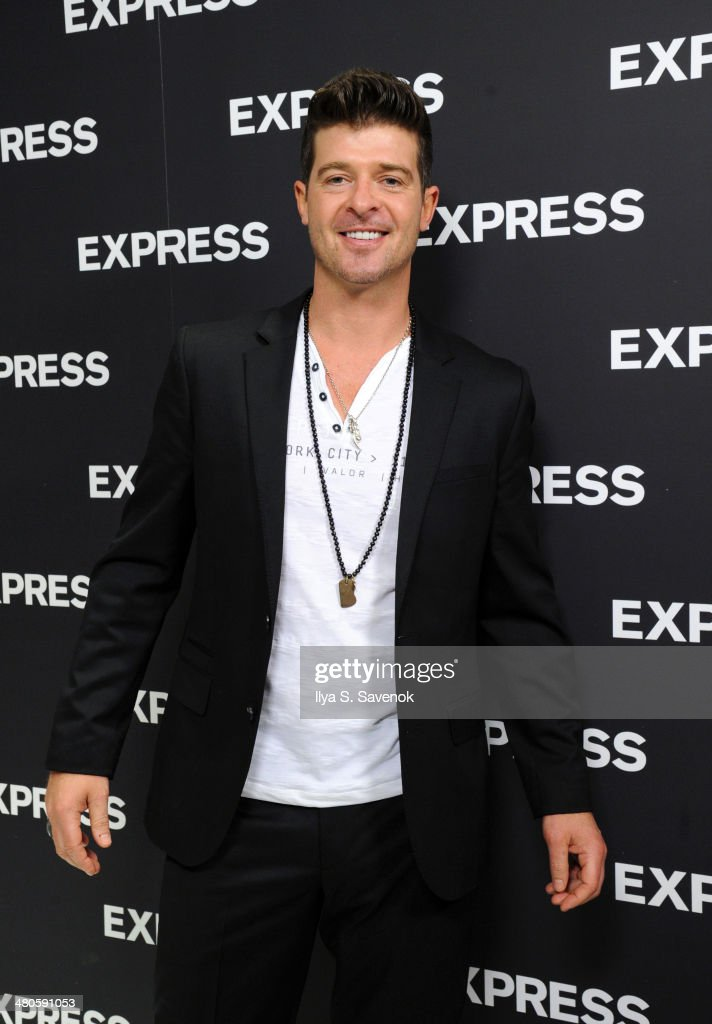 <a gi-track='captionPersonalityLinkClicked' href=/galleries/search?phrase=Robin+Thicke&family=editorial&specificpeople=724390 ng-click='$event.stopPropagation()'>Robin Thicke</a> attends the EXPRESS Times Square Grand Opening Event at EXPRESS Times Square on March 25, 2014 in New York City.