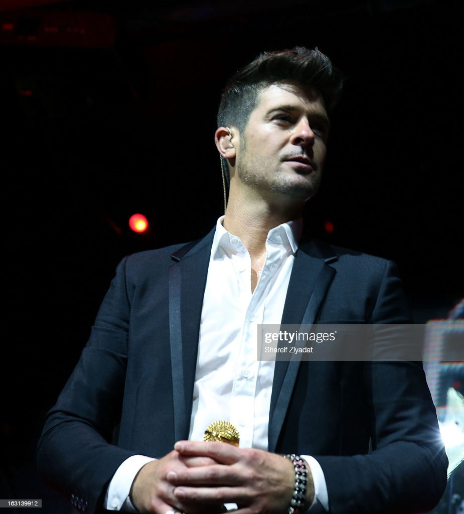 <a gi-track='captionPersonalityLinkClicked' href=/galleries/search?phrase=Robin+Thicke&family=editorial&specificpeople=724390 ng-click='$event.stopPropagation()'>Robin Thicke</a> attends the Remy Martin V.S.O.P Ringleader Culmination Event with <a gi-track='captionPersonalityLinkClicked' href=/galleries/search?phrase=Robin+Thicke&family=editorial&specificpeople=724390 ng-click='$event.stopPropagation()'>Robin Thicke</a> at Marquee on March 4, 2013 in New York City.