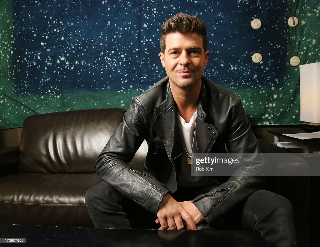 <a gi-track='captionPersonalityLinkClicked' href=/galleries/search?phrase=Robin+Thicke&family=editorial&specificpeople=724390 ng-click='$event.stopPropagation()'>Robin Thicke</a> films Music Choice's Take Back Your Music Campaign at MSR Studios on July 18, 2013 in New York City.