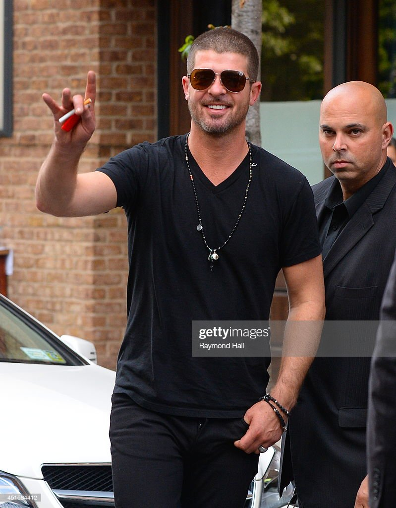 <a gi-track='captionPersonalityLinkClicked' href=/galleries/search?phrase=Robin+Thicke&family=editorial&specificpeople=724390 ng-click='$event.stopPropagation()'>Robin Thicke</a> is seen in Soho on July 1, 2014 in New York City.
