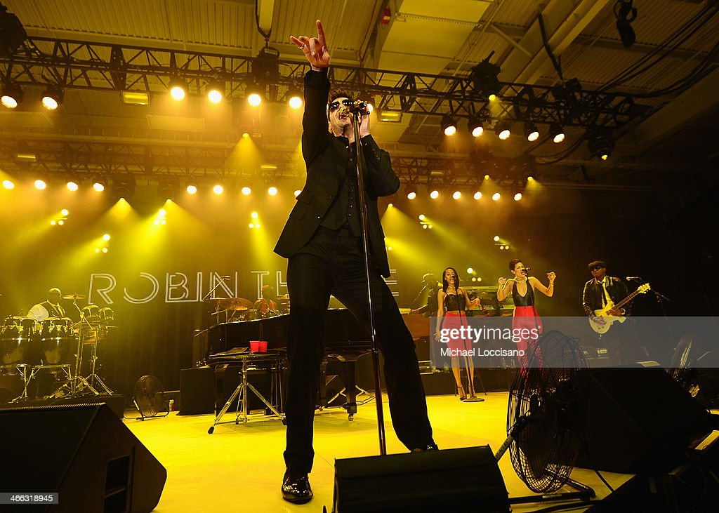 Robin Thicke performs at ESPN The Party at Basketball City Pier 36 South Street on January 31st 2014 in New York City