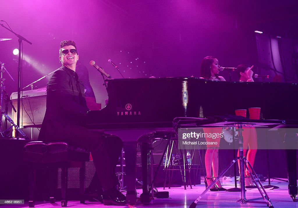 <a gi-track='captionPersonalityLinkClicked' href=/galleries/search?phrase=Robin+Thicke&family=editorial&specificpeople=724390 ng-click='$event.stopPropagation()'>Robin Thicke</a> performs at ESPN The Party at Basketball City - Pier 36 - South Street on January 31st, 2014 in New York City.