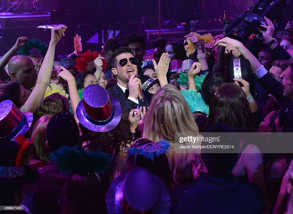 <a gi-track='captionPersonalityLinkClicked' href=/galleries/search?phrase=Robin+Thicke&family=editorial&specificpeople=724390 ng-click='$event.stopPropagation()'>Robin Thicke</a> performs during Dick Clark's New Year's Rockin' Eve with Ryan Seacrest 2014 at Sunset Gower Studios on December 31, 2013 in Los Angeles, California.