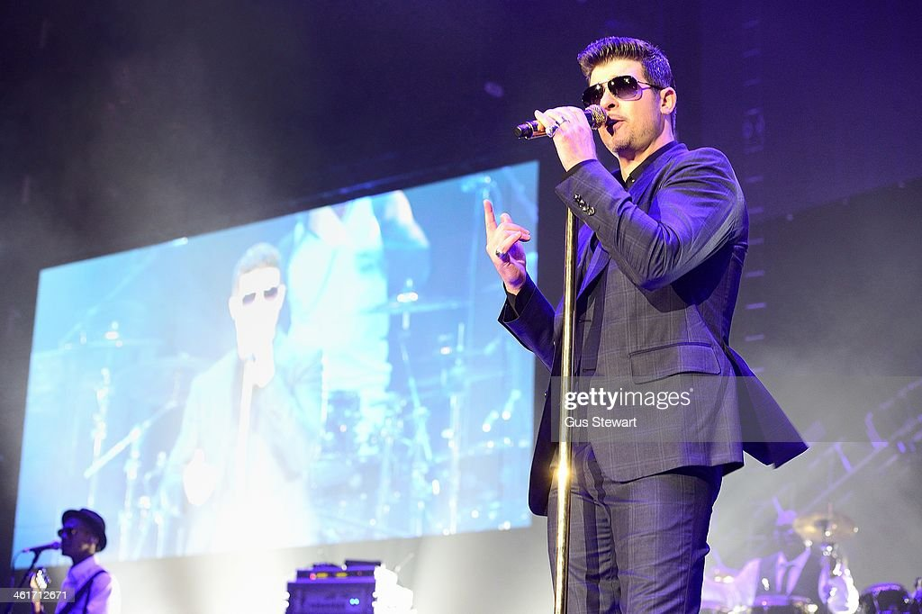 <a gi-track='captionPersonalityLinkClicked' href=/galleries/search?phrase=Robin+Thicke&family=editorial&specificpeople=724390 ng-click='$event.stopPropagation()'>Robin Thicke</a> performs on stage at O2 Arena on January 10, 2014 in London, United Kingdom.
