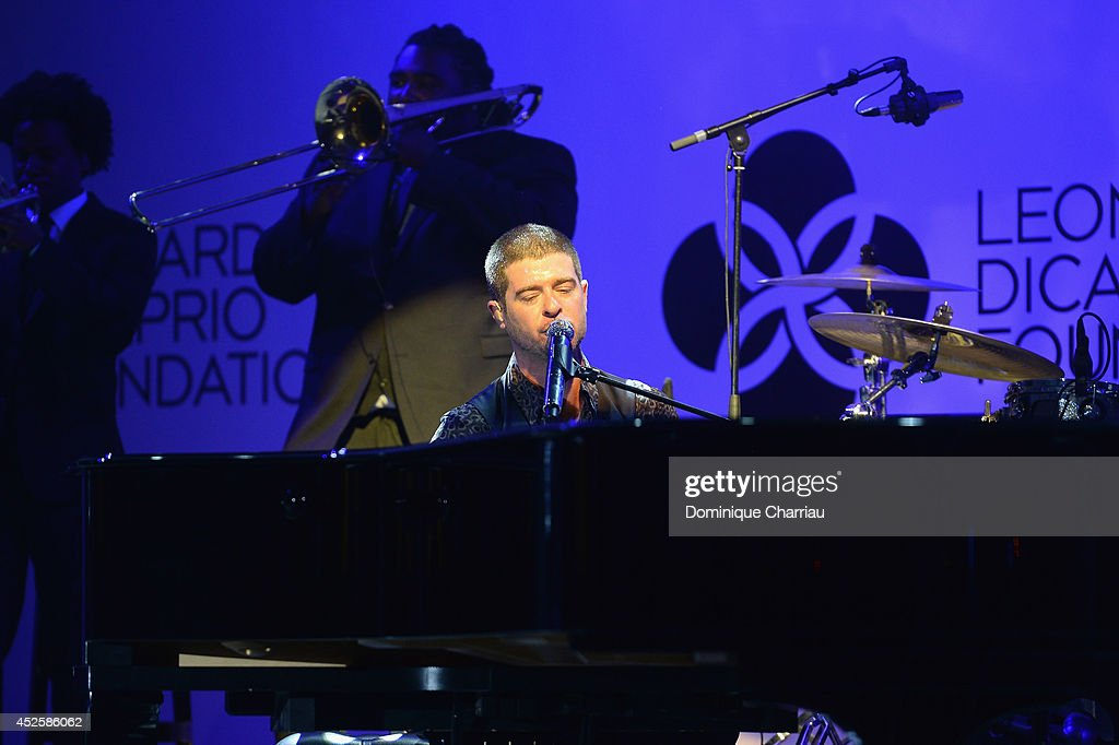<a gi-track='captionPersonalityLinkClicked' href=/galleries/search?phrase=Robin+Thicke&family=editorial&specificpeople=724390 ng-click='$event.stopPropagation()'>Robin Thicke</a> performs on stage during the Leonardo Dicaprio Foundation Launch at Domaine Bertaud Belieu on July 23, 2014 in Saint-Tropez, France.