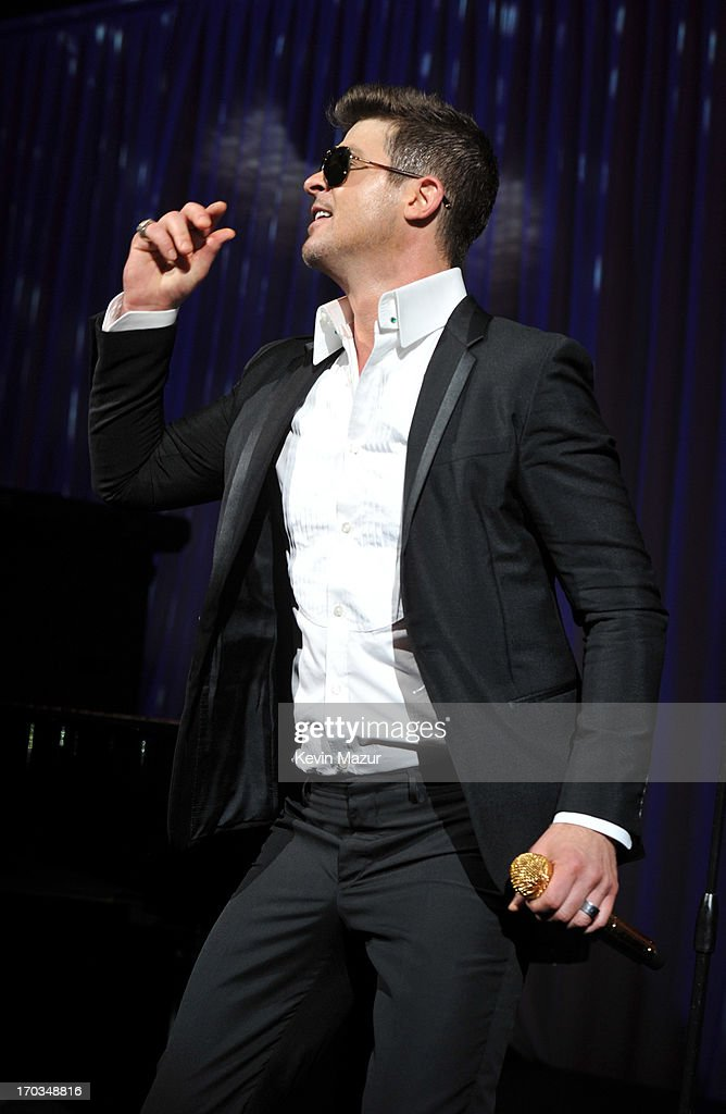 <a gi-track='captionPersonalityLinkClicked' href=/galleries/search?phrase=Robin+Thicke&family=editorial&specificpeople=724390 ng-click='$event.stopPropagation()'>Robin Thicke</a> performs on stage during the Samsung's Annual Hope for Children Gala at CiprianiÕs in Wall Street on June 11, 2013 in New York City.