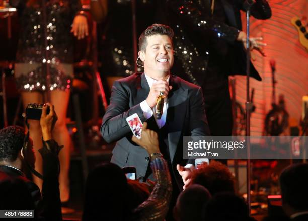 Robin Thicke performs onstage during the Clive Davis and The Recording Academy present The Annual PreGRAMMY Gala held at The Beverly Hilton Hotel on...