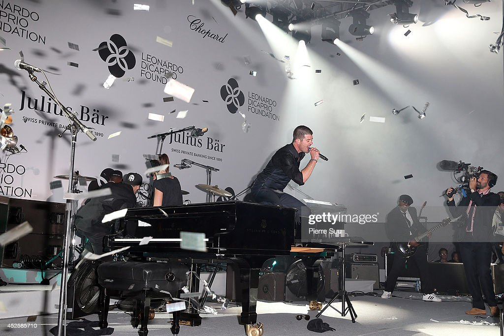 <a gi-track='captionPersonalityLinkClicked' href=/galleries/search?phrase=Robin+Thicke&family=editorial&specificpeople=724390 ng-click='$event.stopPropagation()'>Robin Thicke</a> performs onstage during the Leonardo Dicaprio Foundation Inaugurational Gala at Domaine Bertaud Belieu on July 23, 2014 in Saint-Tropez, France.