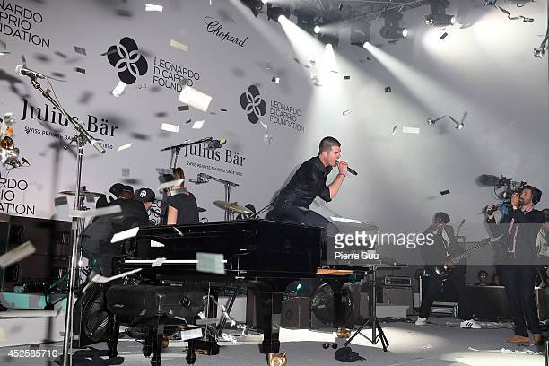 Robin Thicke performs onstage during the Leonardo Dicaprio Foundation Inaugurational Gala at Domaine Bertaud Belieu on July 23 2014 in SaintTropez...
