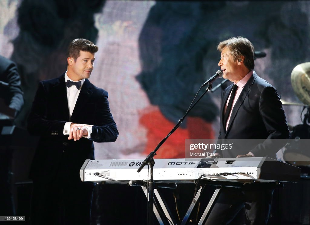 <a gi-track='captionPersonalityLinkClicked' href=/galleries/search?phrase=Robin+Thicke&family=editorial&specificpeople=724390 ng-click='$event.stopPropagation()'>Robin Thicke</a> (C) performs with Chicago perform onstage during the 56th GRAMMY Awards held at Staples Center on January 26, 2014 in Los Angeles, California.