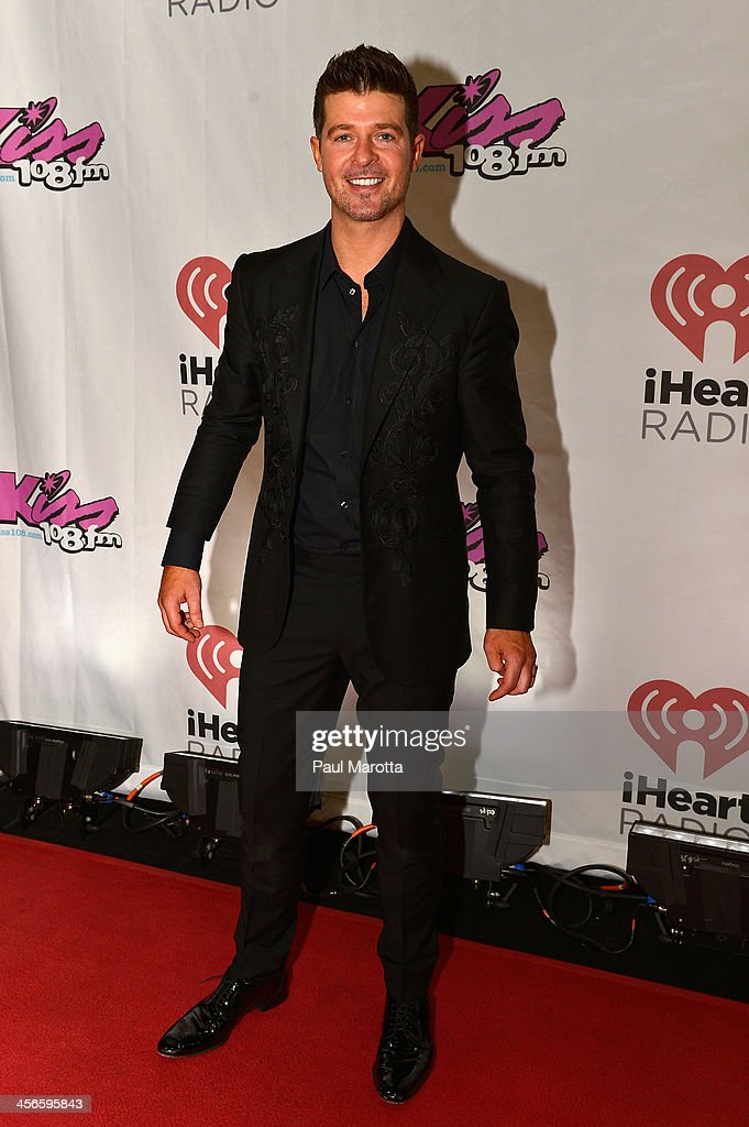 <a gi-track='captionPersonalityLinkClicked' href=/galleries/search?phrase=Robin+Thicke&family=editorial&specificpeople=724390 ng-click='$event.stopPropagation()'>Robin Thicke</a> poses backstage at KISS 108's Jingle Ball 2013 at TD Garden on December 14, 2013 in Boston, MA.