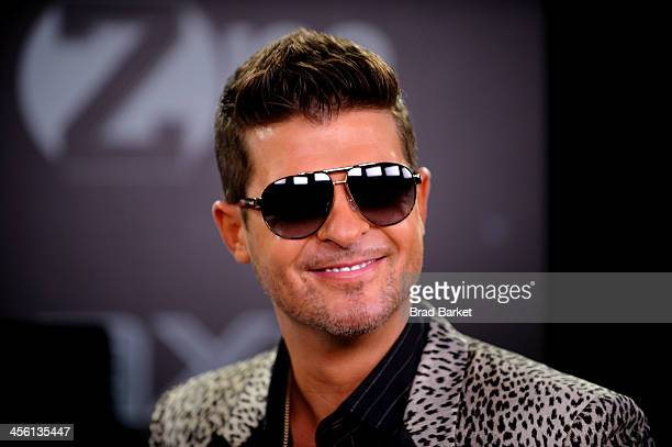 Robin Thicke poses backstage at Z100's Jingle Ball 2013 presented by Aeropostale at Madison Square Garden on December 13 2013 in New York City