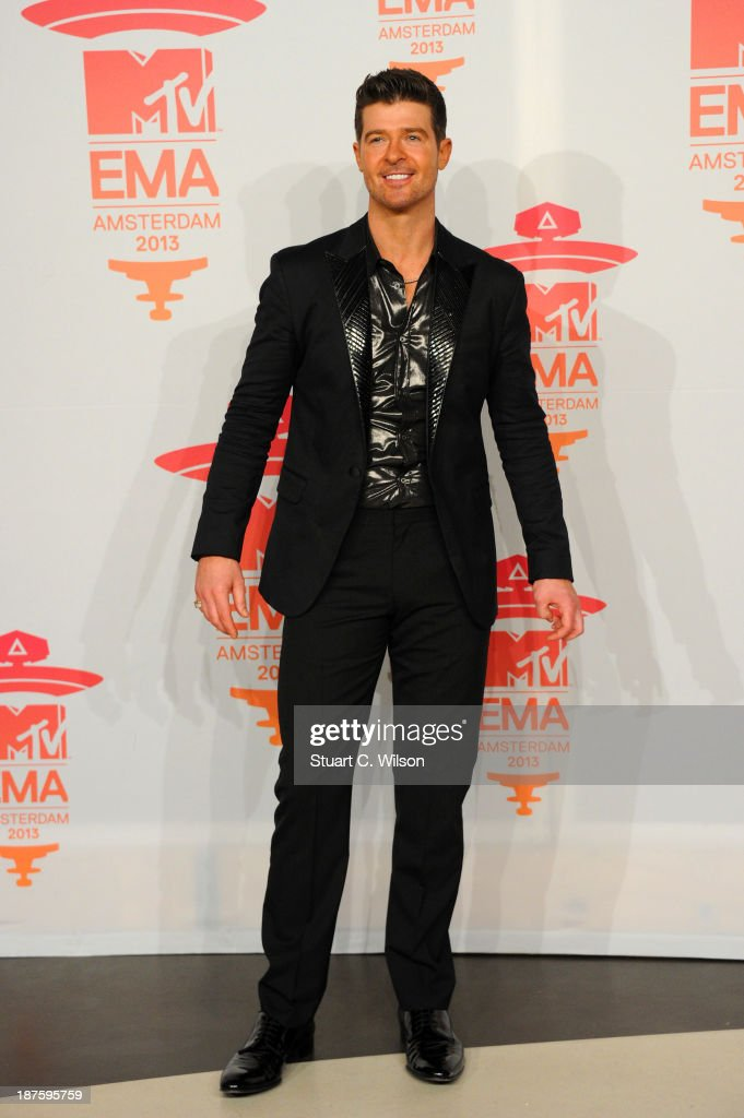 <a gi-track='captionPersonalityLinkClicked' href=/galleries/search?phrase=Robin+Thicke&family=editorial&specificpeople=724390 ng-click='$event.stopPropagation()'>Robin Thicke</a> poses in the photo room during the MTV EMA's 2013 at the Ziggo Dome on November 10, 2013 in Amsterdam, Netherlands.