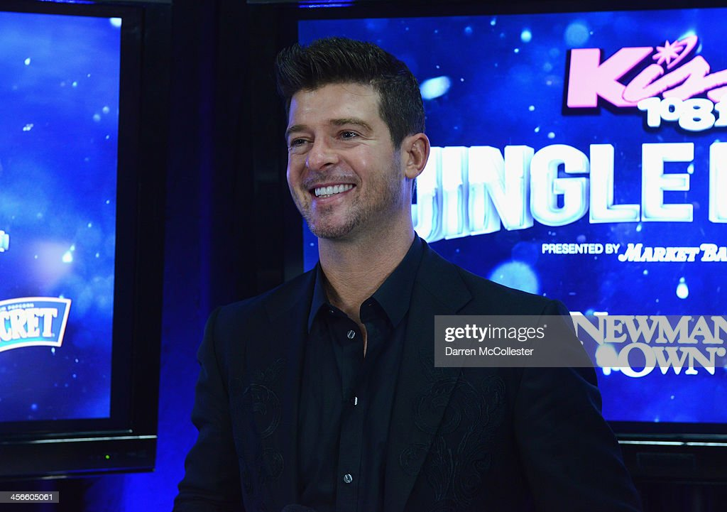 <a gi-track='captionPersonalityLinkClicked' href=/galleries/search?phrase=Robin+Thicke&family=editorial&specificpeople=724390 ng-click='$event.stopPropagation()'>Robin Thicke</a> talks backstage at KISS 108's Jingle Ball 2013 at TD Garden on December 14, 2013 in Boston, MA.